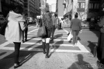 Backs of people walking in the city